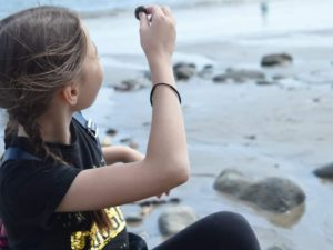 Girl beachcombing